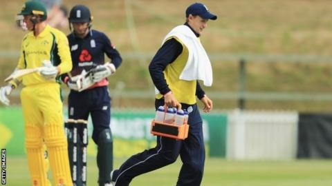 Joe Root carrying drinks