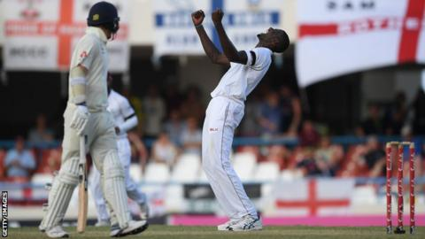 West Indies captain Jason Holder celebrates after taking the last wicket of James Anderson during the second Test against Englnd