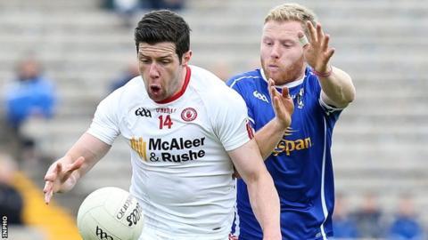 Tyrone's Sean Cavanagh battles with Cavan's James McEnroe in last year's Ulster semi-final replay