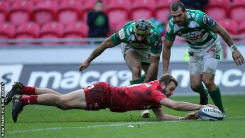 Paul Asquith dives full length to score Scarlets' winning try with two Benetton defenders unable to stop him