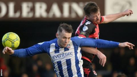 Coleraine's Darren McAuley battles with Crusaders' Billy Joe Burns at the game in January