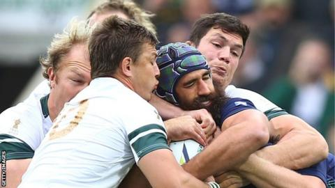 Josh Strauss is smothered by the Boks
