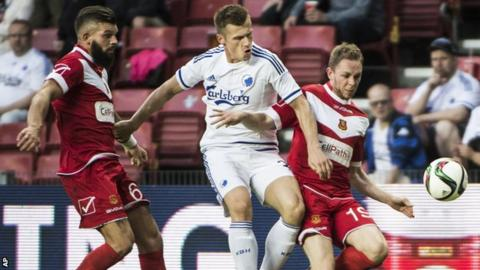Shane Sutton, left, and Craig Williams from Newtown battle for the ball with FC Copenhagen's Marvin Pourie