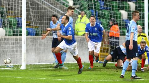 The ball nestles in the Ballymena net as Guy Bates fires in an equaliser early in the second half