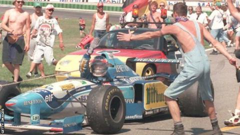 Michael Schumacher celebrates winning the 1995 German Grand Prix for Benetton-Renault at Hockenheim