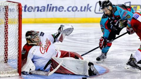 Colin Shields of the Belfast Giants tries to beat Cardiff goaltender Ben Bowns