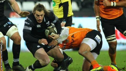 Jeff Hassler of Ospreys is tackled by Nico Lee of Cheetahs