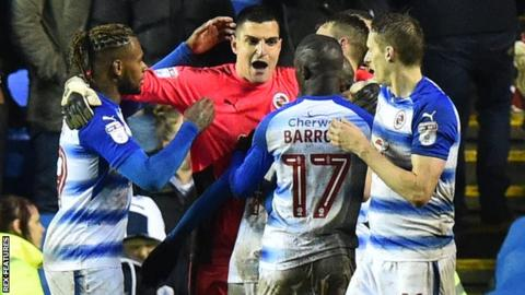 Reading celebrate Vito Manone's penalty save