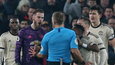 Manchester United keeper David de Gea was booked after he confronted the referee