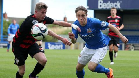 Lyndon Kane and Joel Cooper battle for possession as Glenavon beat Coleraine 3-0 at Mourneview Park