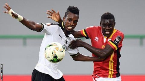 Uganda's forward Muhammad Shaban (right) challenges Ghana's defender John Boye