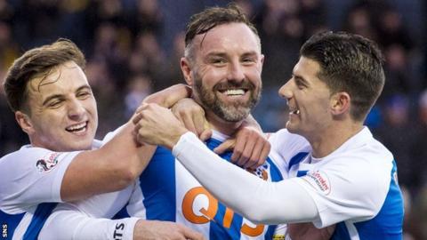 Eamonn Brophy and Jordan Jones help Krsi Boyd (centre) celebrate a goal for Kilmarnock