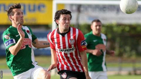Cork midfielder Liam Millar closes in on Derry's Barry McNamee