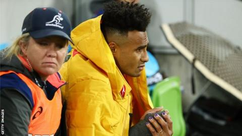 Australia scrum-half Will Genia cuts a forlorn figure on the bench after coming off injured in Melbourne