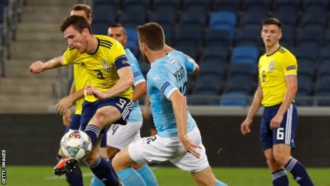 Andrew Robertson clears as Kieran Tierney looks on in Scotland's 2-1 loss to Israel