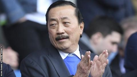 Cardiff City owner Vincent Tan applauds as he watches his side