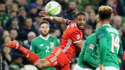 Wales captain Ashley Williams clears as the Republic of Ireland press for a goal in Dublin