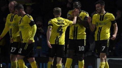 Burton players celebrate