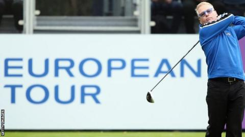 Keith Pelley, European Tour chief, hitting a golf shot
