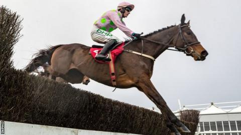 Min clears a fence on his way to victory at the County Kildare track on Sunday