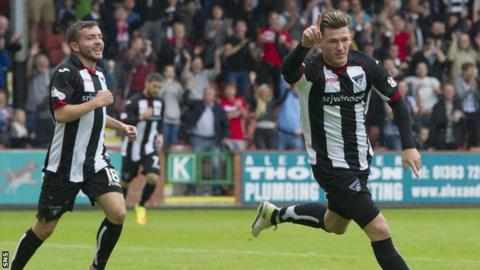 Dunfermline's David Hopkirk (right) celebrates his side's fourth