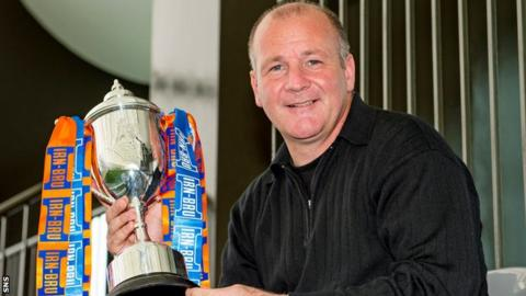 Queen's Park manager Gus MacPherson holds the Scottish Challenge Cup