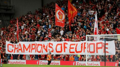 Banners held by Liverpool fans on the Kop before their team's game against Norwich