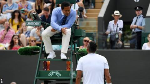Nick Kyrgios speaks with the umpire at Wimbledom