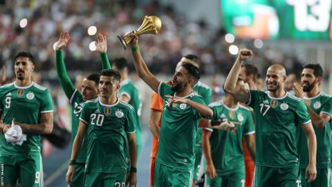 Algeria parade Afcon trophy after beating Benin in first match back home