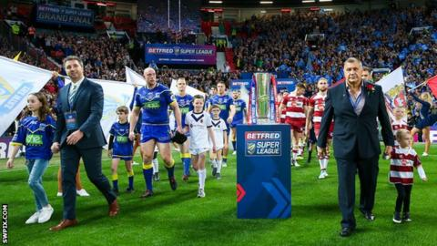 Steve Price (left) leads out Warrington Wolves at Old Trafford