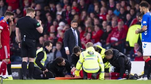 Andrew Considine receives medical attention
