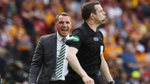 Celtic manager Brendan Rodgers gives assistant referee Douglas Ross some verbals