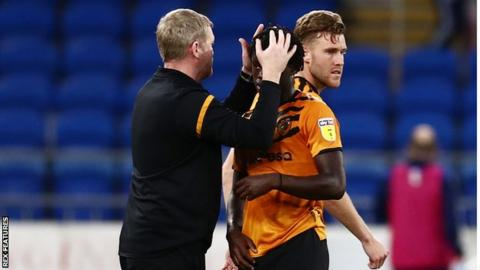 Hull City boss Grant McCann consoles his player after relegation from the Championship