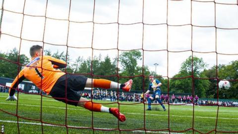 East Kilbride's David Brownlie scores the winning penalty against St Mirren