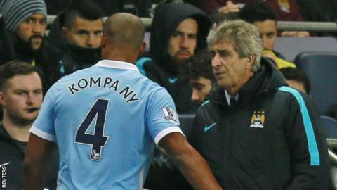Man City defender Vincent Kompany (left) and manager Manuel Pellegrini
