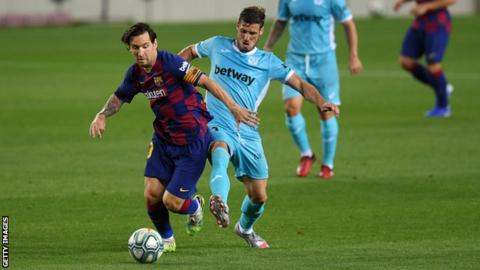 Barcelona's Lionel Messi battles for possession with Ruben Perez of Leganes