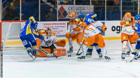 Fife Flyers try to get the puck beyond Sheffield Steelers goalie Ervins Mustukovs
