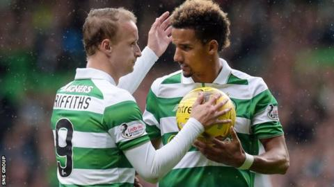 Scott Sinclair takes the ball from Leigh Griffiths