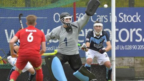Lisnagarvey keeper John Tormey saves against Monkstown