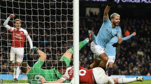 Sergio Aguero celebrates scoring for Manchester City against Arsenal