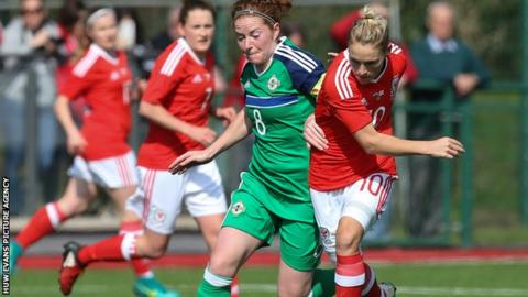 Wales' Jess Fishlock of Wales holds off Marissa Callaghan of Northern Ireland