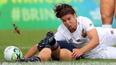 Sarah Hunter battles for the ball with Kris Thomas