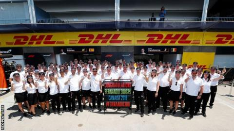 Fernando Alonso, McLaren, raises a glass in celebration of his 300th Grand Prix appearance