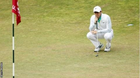 Rory McIlroy surveys the 12th green