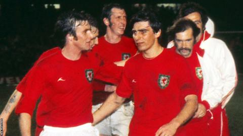 Leighton Phillips and Dave Smallman lead Wales' celebrations after a 1-0 win over Austria in Wrexham secured a place in the 1976 European Championship quarter finals.