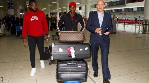 Rapid Vienna left-back Boli Bolingoli-Mbombo (centre) arrives at Glasgow Airport