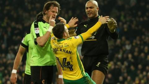 Norwich's Wes Hoolahan was caught off balance by Wolves keeper Carl Ikeme's push in the chest