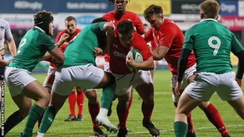 Josh Reynolds of Wales takes on Jack Aungier of Ireland
