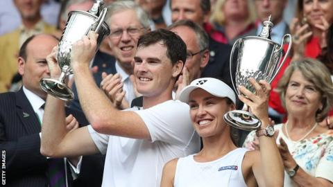 Jamie Murray and Martina Hingis celebrate their Wimbledon mixed doubles title in 2017