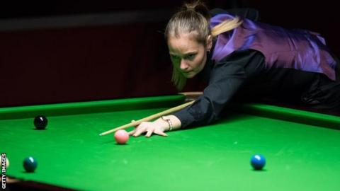 Snooker player Reanne Evans takes a shot
